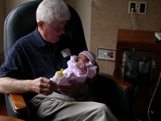 Grandpa and Owen at three days old