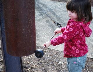 Barrett ringing the big gong, NC Arboretum
