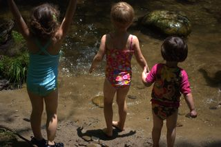 Cousins throwing rocks