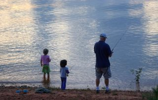 Fishing with Grandpa at sunset