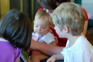 Samantha reading to Owen, Barrett, and Daisy