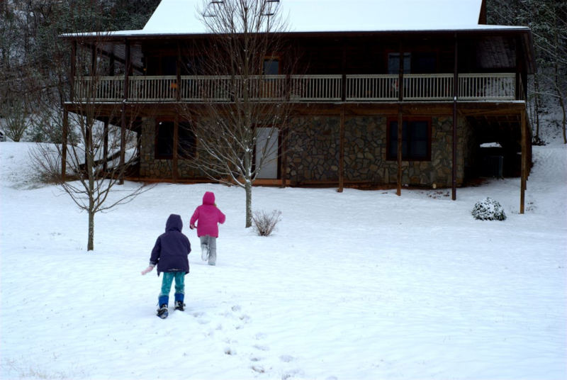Girls running toward cabin