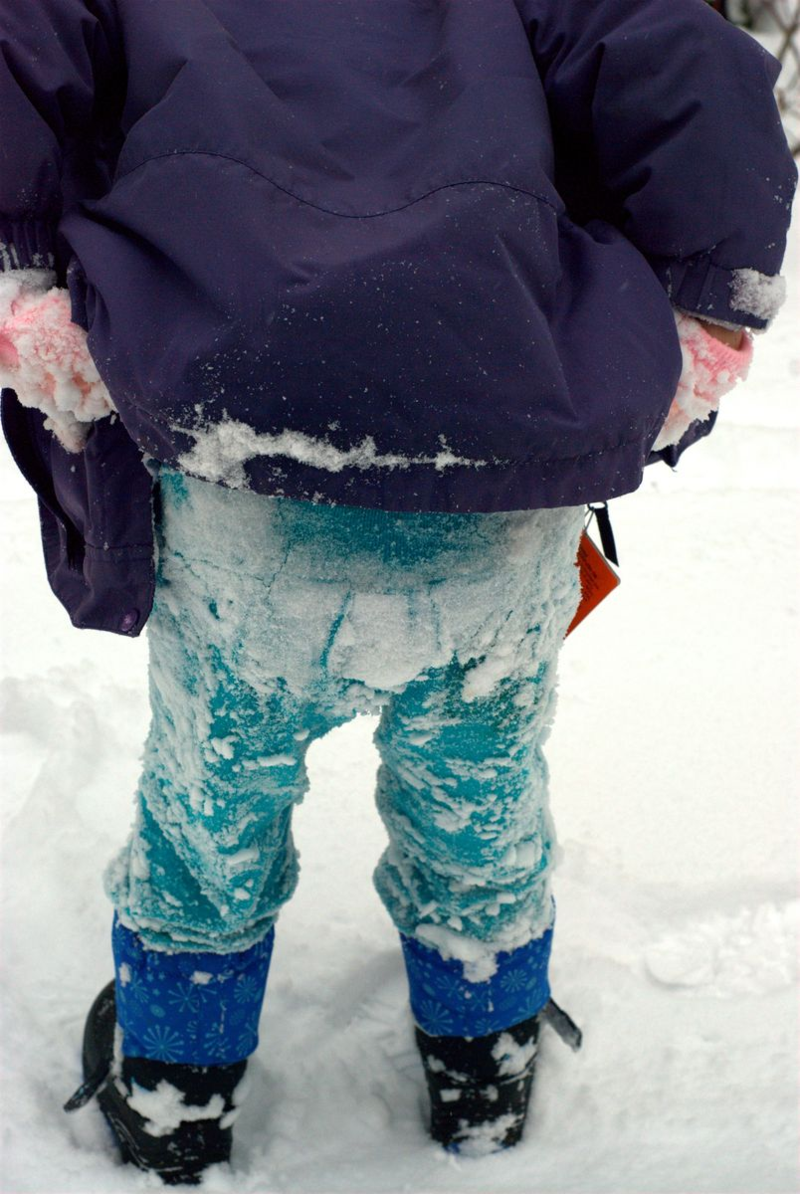 Snow on girl's pants bottoms