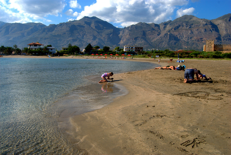 Building sand castles in view of the castle at Frangokastelli and the Lefka Mountains