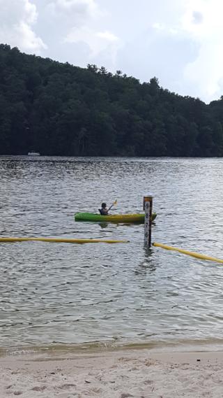 Barrett paddling a kayak